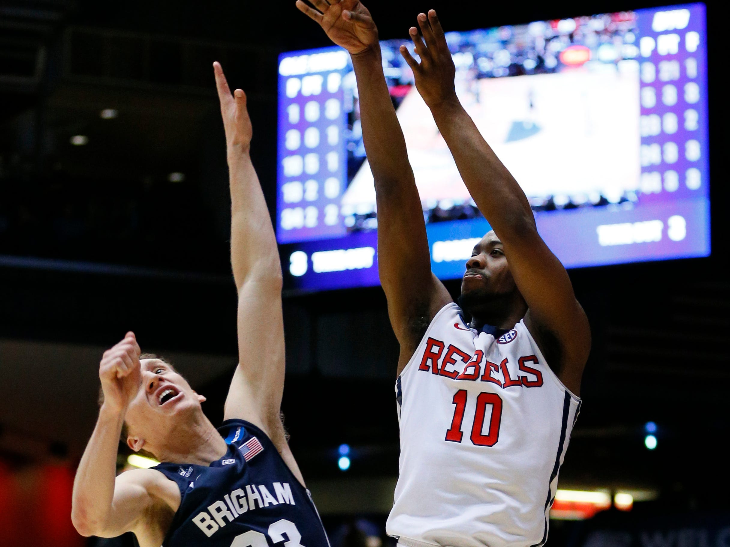 Mar 17, 2015; Dayton, OH, USA; Mississippi Rebels guard Ladarius White (10) shoots while defended by Brigham Young Cougars guard Skyler Halford (23) during the second half in the first round of the 2015 NCAA Tournament at UD Arena. Mandatory Credit: Rick Osentoski-USA TODAY Sports