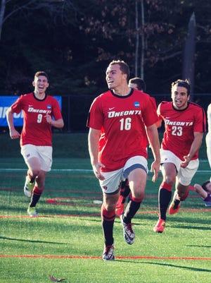 Poughkeepsie native Kevin Hoff, center, celebrates with SUNY Oneonta men's soccer teammates Hans Purtell and Brandon Arango