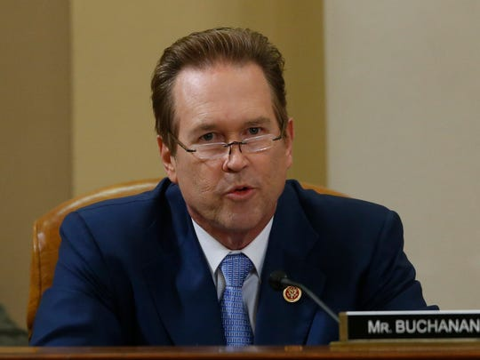 Rep. Vern Buchanan, R-Fla. questions ousted IRS Chief Steve Miller and J. Russell George, Treasury Inspector General for Tax Administration, as they testify during a hearing at the House Ways and Means Committee on the Internal Revenue Service (IRS) practice of targeting applicants for tax-exempt status based on political leanings on Capitol Hill, in Washington, Friday, May 17, 2013. (AP Photo/Charles Dharapak)