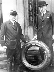 FILE - In this 1930s file photo, General Robert E. Wood, president of Sears, Roebuck & Co., and Julius Rosenwald, chairman of the board, posing for a photo next to an All State tire, outside of the Sears Distribution Center, in Atlanta. Sears has filed for Chapter 11 bankruptcy protection Monday, Oct. 15, 2018, buckling under its massive debt load and staggering losses. (Atlanta Journal-Constitution via AP, File)
