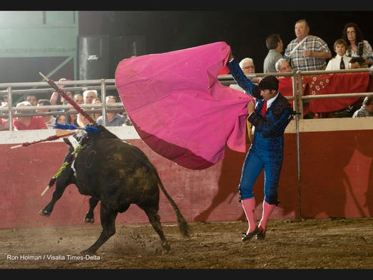 Luis Felipe performs as Tulare's Holy Spirit Celebration kicks off with bloodless bull fights at the fairgrounds on Friday, May 30, 2014.