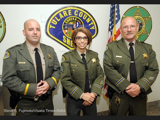 Tulare County Sheriff Mike Boudreaux, not pictured, promoted Ty Stellow, left, to lieutenant and Tiffany Mendoza, center, and David Barber to sergeant. The three were pinned during a promotional ceremony Wednesday afternoon at Sheriff's Headquarters in Visalia.