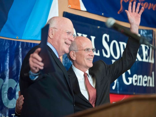 """Rep. Peter Welch, right, celebrates his re-election with Senator Patrick Leahy at Democratic Party headquarters at the Hilton Burlington on Nov. 4. Leahy, a Democrat, voted last year in favor of the stalled The Marketplace Fairness Act. Welch, an original cosponsor of the House bill, said he has """"some optimism"""" about passage next year."""
