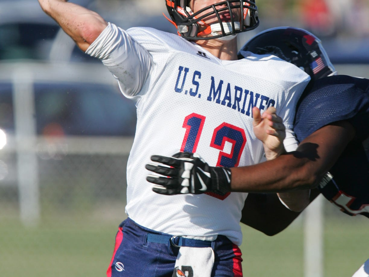 At last year's Basilone Bowl game, Montgomery High school senior, CJ Gatt, throws in the first half of the all star game.
