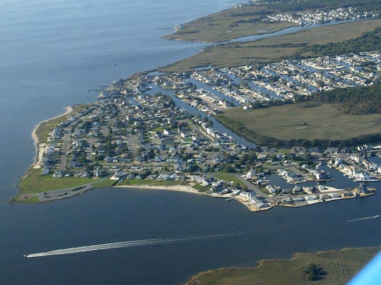 This 2006 photo shows lagoon homes along the Forked River leading into Barnegat Bay.
