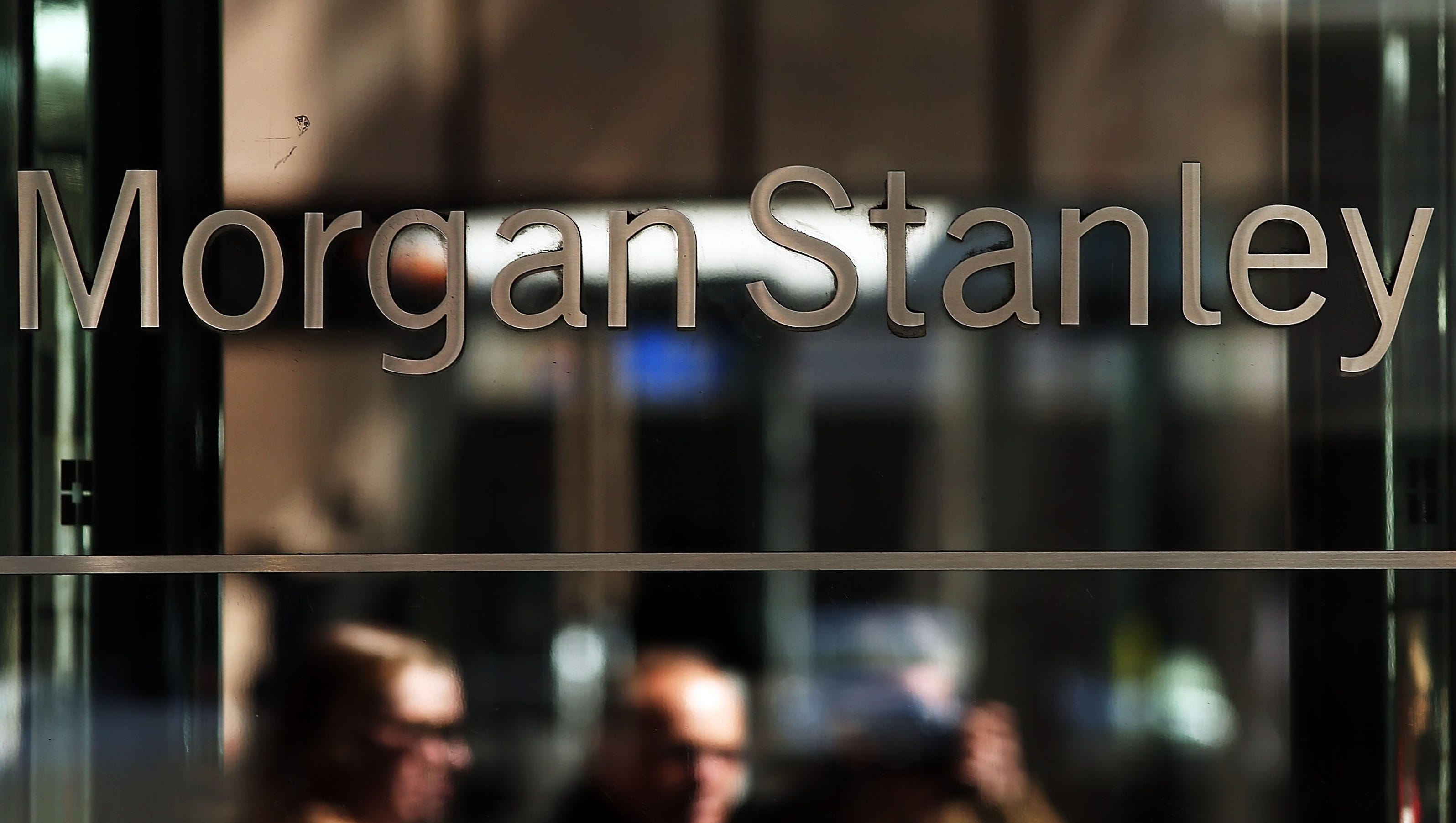 Morgan stanley s income nearly doubles