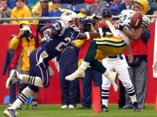 Green Bay Packers' receiver Terry Glenn is unable to hang onto a pass while being defended by New England Patriots' Terrell Buckley during the fourth quarter of their game Sunday, October 13, 2002 at Gillette Stadium in Foxborough, Mass.