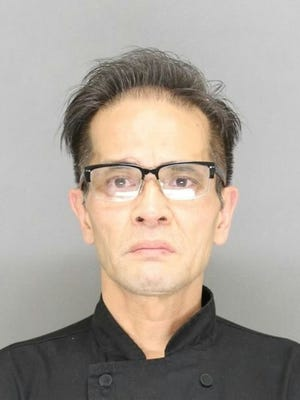 Tai  H. Tran, 54, allegedly began fighting with a former coworker July 3 after crossing paths with him in Downtown Green Bay.