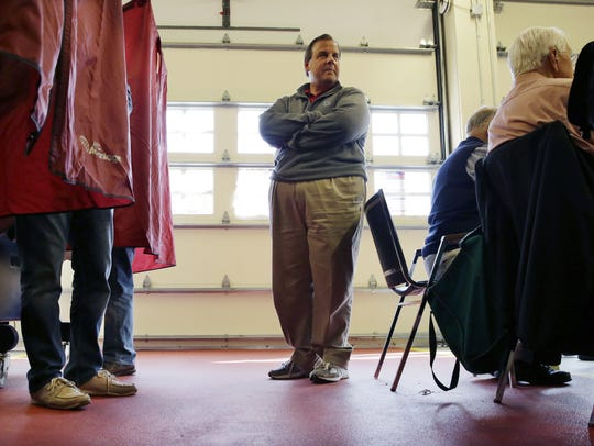 Gov. Chris Christie waits in line to vote Tuesday in