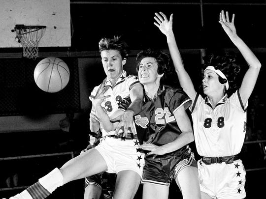 Sally Nerren, right, and Judy Coble, left, of Nashville Business College, and Betty Scott of Wayland Baptist, compete for the ball at Litton High School gym on  Jan. 21, 1963.