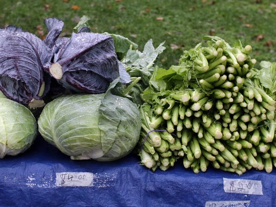 Cabbage and celery await buyers at the Fountain Park Farmers Market Wednesday October 12, 2016 in Sheboygan.