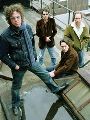 Members of The Jayhawks pose on a roof in 2003 in New