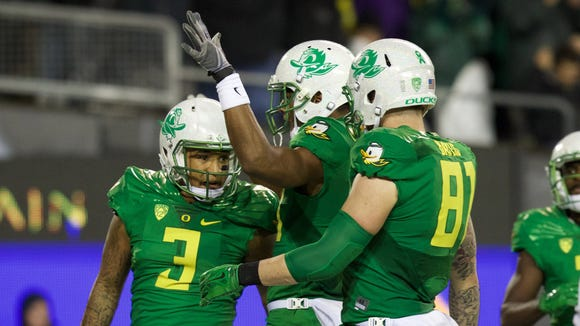Nov 7, 2015; Eugene, OR, USA; Oregon Ducks quarterback Vernon Adams Jr. (3) and tight end Evan Baylis (81) celebrate a touchdown in the second quarter against the California Golden Bears at Autzen Stadium. Mandatory Credit: Scott Olmos-USA TODAY Sports