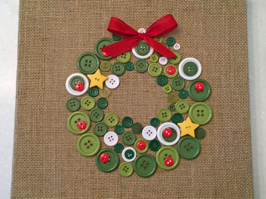 Make a festive wall hanging by gluing buttons to a burlap canvas.