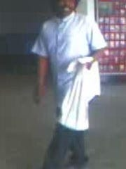 A security camera image of a man suspected of using