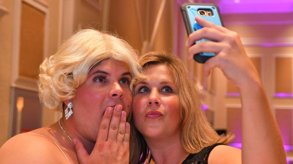 Frank LaBella, Jr. as Marilyn Monroe poses for a selfie with Susan Naylor of the SPCA of Brevard. The 2017 Dude Looks Like a Lady event was held at the Radisson Resort at the Port to benefit the Women's Center in their fight against domestic violence and other issues. Ten Brevard men, and Master of Ceremonies Sheriff Wayne Ivey, dressed up as famous female celebrities to bring in over $150,000 and counting to the cause.