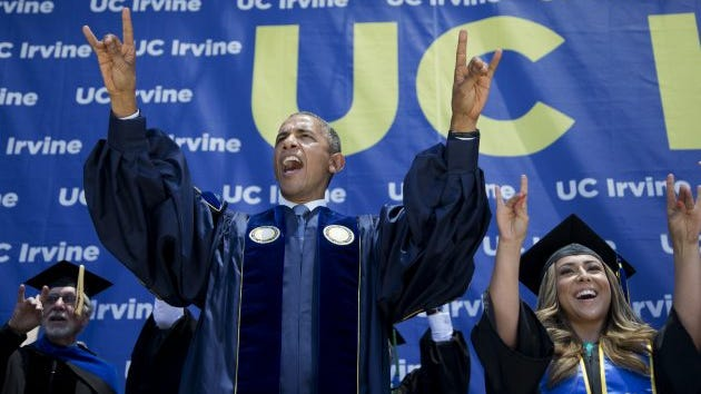 President Obama flashes the symbol of the school mascot --<br />the Anteaters -- after delivering his commencement address to the graduates of University of California-Irvine in Anaheim, Calif., Saturday, June 14,  2014.