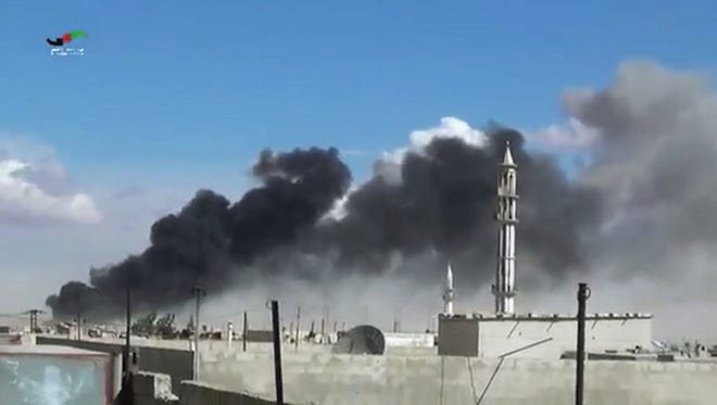 In this image made from video provided by Homs Media Centre, which has been verified and is consistent with other AP reporting, smoke rises after airstrikes by military jets in Talbiseh of the Homs province, western Syria, Wednesday, Sept. 30, 2015. Russian military jets carried out airstrikes in Syria for the first time on Wednesday, targeting what Moscow said were Islamic State positions. U.S. officials and others cast doubt on that claim, saying the Russians appeared to be attacking opposition groups fighting Syrian government forces.