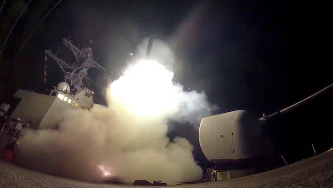 In this image from video provided by the U.S. Navy, the guided-missile destroyer USS Porter (DDG 78) launches a tomahawk land attack missile in the Mediterranean Sea, Friday, April 7, 2017. The United States blasted a Syrian air base with a barrage of cruise missiles in fiery retaliation for this week's gruesome chemical weapons attack against civilians.  (Mass Communication Specialist 3rd Class Ford Williams/U.S. Navy via AP)