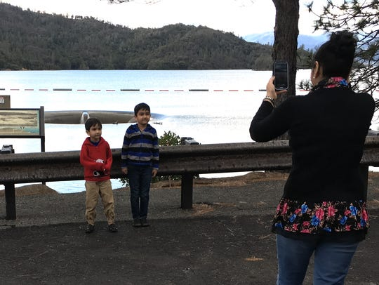 Binny Bawa of Redding takes a picture of her two sons,