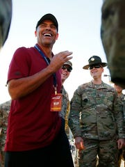 ASU football coach Herm Edwards talks to Army reservists