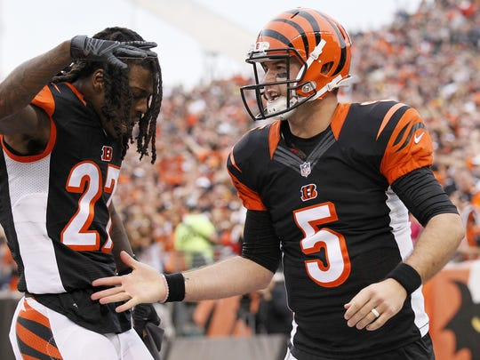 Former Alabama teammates Dre Kirkpatrick and AJ McCarron celebrate McCarron's first career touchdown, which came Dec. 13 against the Steelers.