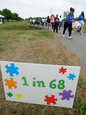 People take part in the Walk for Autism at Ida Bell Young Park in Montgomery, Ala. on Saturday April 5, 2014.