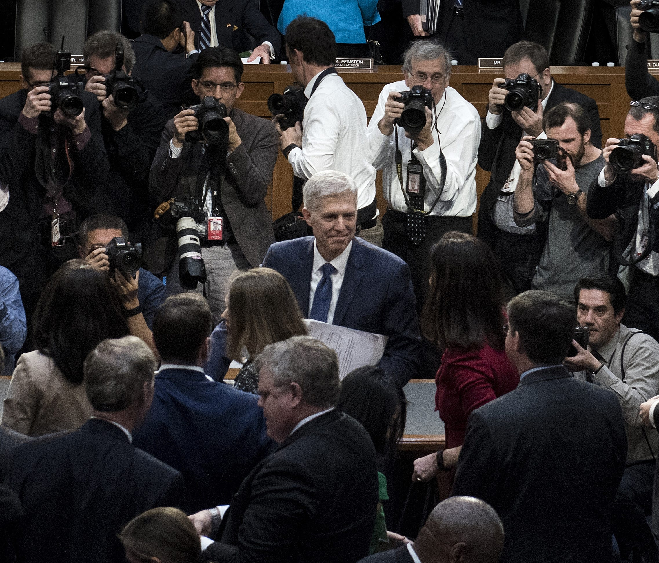 Supreme Court nominee Neil Gorsuch leaves a Senate hearing room on March 20, 2017, after the first day of his confirmation hearing for a seat on the Supreme Court.