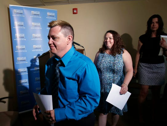 Jesse Vroegh and his wife, Jackie, back, leave the