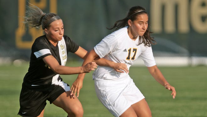 Hartland's Sakura Bals and her teammates will take on Brighton for a district title on Saturday.