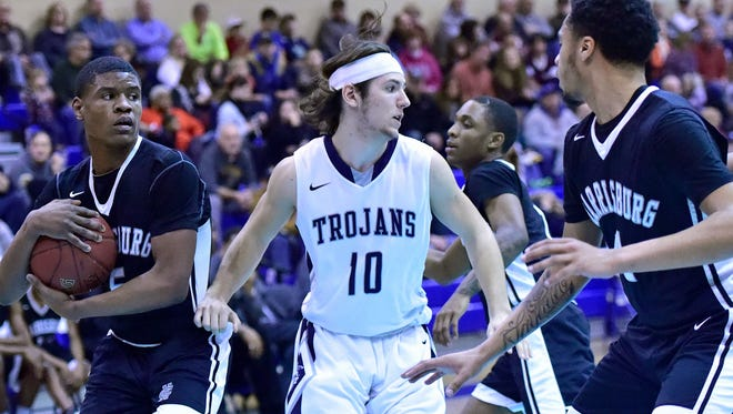 Harrisburg's Nycier Brannon, left,  protects a rebound as Seth Brouse (10) of Chambersburg heads down the court. Chambersburg hosted Harrisburg in boys basketball Friday, February 2, 2018. The Trojans won 55-54.