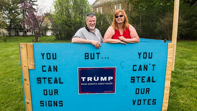 Donald Peters and Karen Kocher stand with their Trump sign outside of their home in Abbottstown.