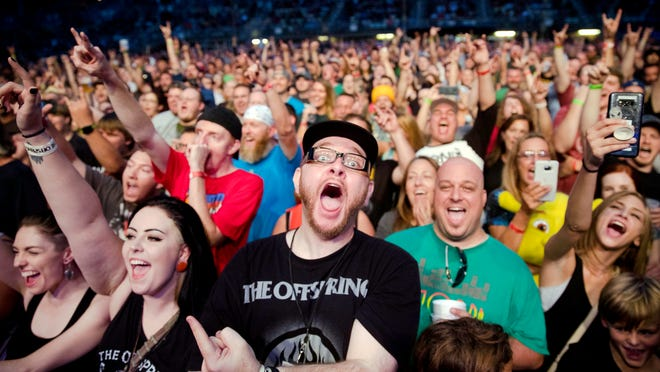 Fans scream for The Offspring during their performance at the Illinois State Fair Wednesday, Aug. 15, 2018.