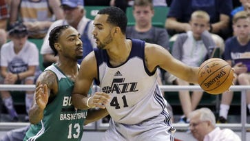 Rick Bowmer/AP  The Celtics? James Young, left, defends the Jazz?s Trey Lyles during the first half of an NBA summer league basketball game Tuesday in Salt Lake City. Boston Celtics' James Young (13) defends Utah Jazz's Trey Lyles (41) during the first half of an NBA summer league basketball game Tuesday, July 5, 2016, in Salt Lake City.