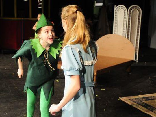 Meagan Haupt, who plays Peter Pan, interacts with Annie