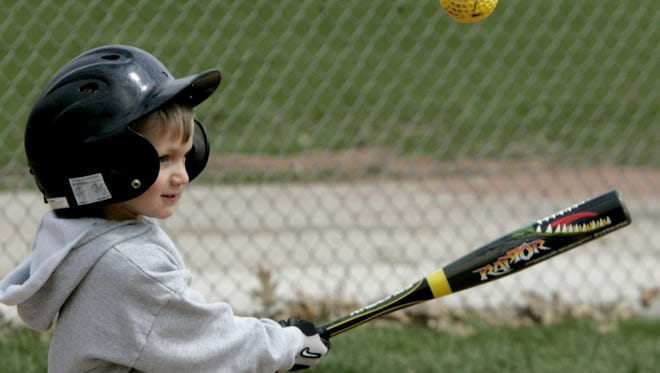 Greenfield Little Leaguer Alex Mauhar, 5, pops up a pitch two years ago at batting and fielding practice at Kulwicki Park.