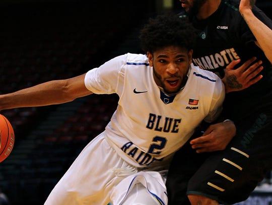 MTSU forward Perrin Buford drives to the basket against