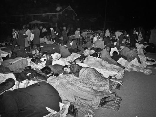 In this March 11, 1965 file photo, voters rights demonstrators sleep on the street in Selma, Ala. after several attempted marches were halted by police.