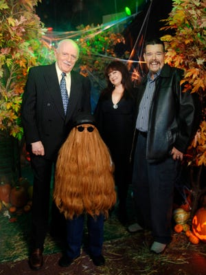 """This Oct. 31, 2006 photo provided by ABC, shows some of the original cast of the TV show, """"The Addams Family,"""" from left, John Astin, (Gomez Addams), Felix Silla, (Cousin Itt), Lisa Loring, (Wednesday Addams) and Ken Weatherwax, (Pugsley Addams), reunited at a special Halloween edition of ABC's """"Good Morning America"""" outside their Times Square studios in New York.  Weatherwax, who played the child character Pugsley on """"The Addams Family"""" television series in the 1960s, has died. He was 59.  (AP Photo/ ABC, Ida Mae Astute)"""