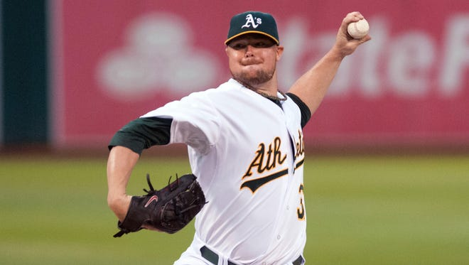 Athletics starting pitcher Jon Lester throws a pitch against the  Phillies during the second inning at O.co Coliseum.