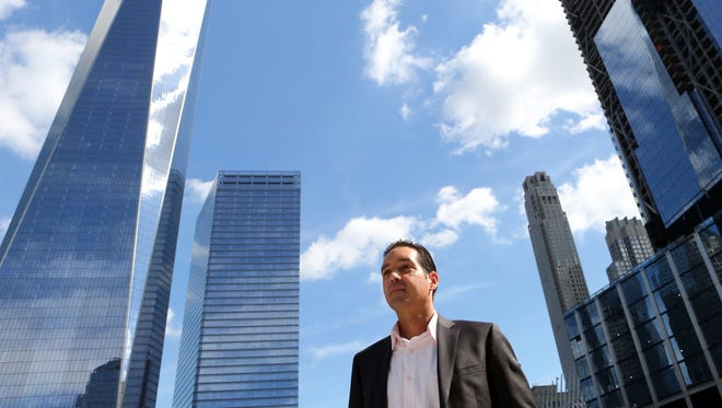 Glenn Guzi, program director for the World Trade Center at the Port Authority of New York and New Jersey, at the World Trade Center site in Manhattan. Guzi, a Peekskill resident, took the day off on 9/11 to run errands. He has since been driven to see the site restored.
