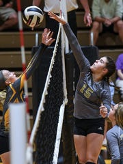 Crescent sophomore Kamryn Dove(5) tries to block a shot by Pendleton freshman Taylor Furbee (15) during the third set at Pendleton High School in Pendleton on Thursday. Crescent won in three sets, 25-15, 25-13, and 25-18.