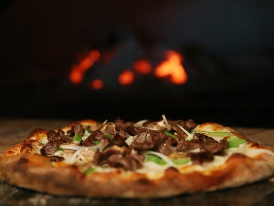 Fresh wood-fired pizza out of the oven at Six50 in