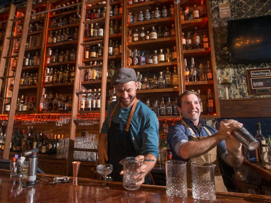 Bartenders Patrick Bolster, owner of the Union Public House,  left, and Andrew Pope, of the Old Hickory Whiskey Bar, show off their skills at the Old Hickory Whiskey Bar in Pensacola on Monday, March 20, 2017.  Pope and Bolster are among the founders of the new Pensacola chapter of the United States Bartenders' Guild.