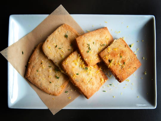 Garage Bar's shortbread cookies, sprinkled with lemon zest and thyme. The lemon and thyme are also incorporated into the shortbread batter. The cookies are often served with the bistro's poppy seed cheesecake.05 October 2017