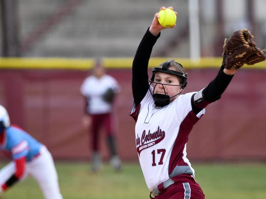 Henderson County's Kelsie Hill (17)  pitches as the Lady Colonels play the Union County Bravettes at Henderson's North Field Tuesday, April 10, 2018.