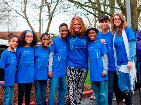 FILE - This March 20, 2016, file photo shows Hart family of Woodland, Wash., at a Bernie Sanders rally in Vancouver, Wash. A body was recovered Saturday, April 7, 2018, in the vicinity where an SUV plunged off a Northern California cliff last month, killing the family of eight in what authorities suspect may have been an intentional crash. One of the women were drunk when she drove her large family off a Northern California cliff last month and her wife and several children had large amounts of a drug in their systems that can cause drowsiness, authorities said Friday, April 13, 2018.