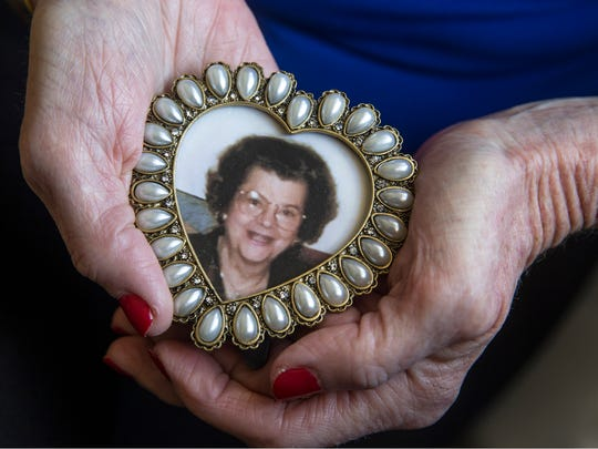 Denise Ely shows a photo of Geraldine Hodges who donated her liver at the age of 75.