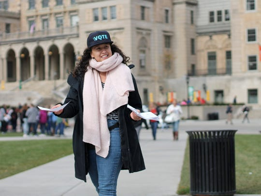 Maia Berlow, NextGen Wisconsin field organizer for Madison, Wis., canvasses to encourage students to vote early on Oct. 30, 2018, on the University of Wisconsin-Madison campus.