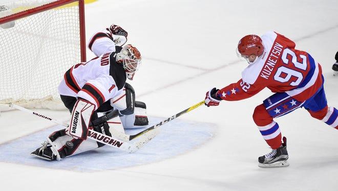 Devils goalie Keith Kinkaid (1) stops Washington Capitals center Evgeny Kuznetsov during a shootout of a game, Thursday, Dec. 29, 2016, in Washington. The Devils won 2-1 in the shootout.